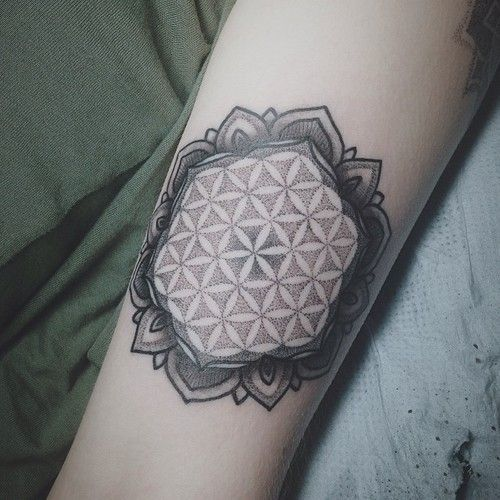 Dotwork flower of life tattoo with a lotus flower frame