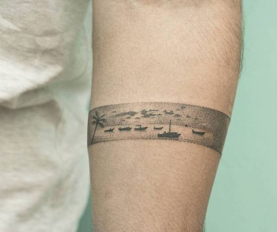 Dotwork landscape of sea and boats armband tattoo