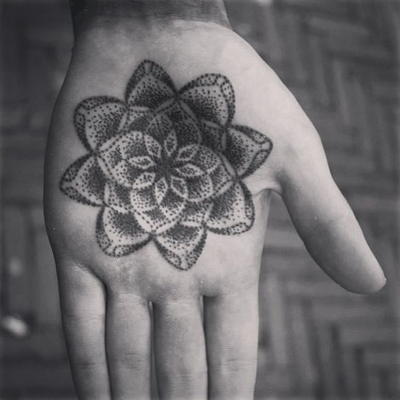 Dotwork mandala tattoo on the left palm