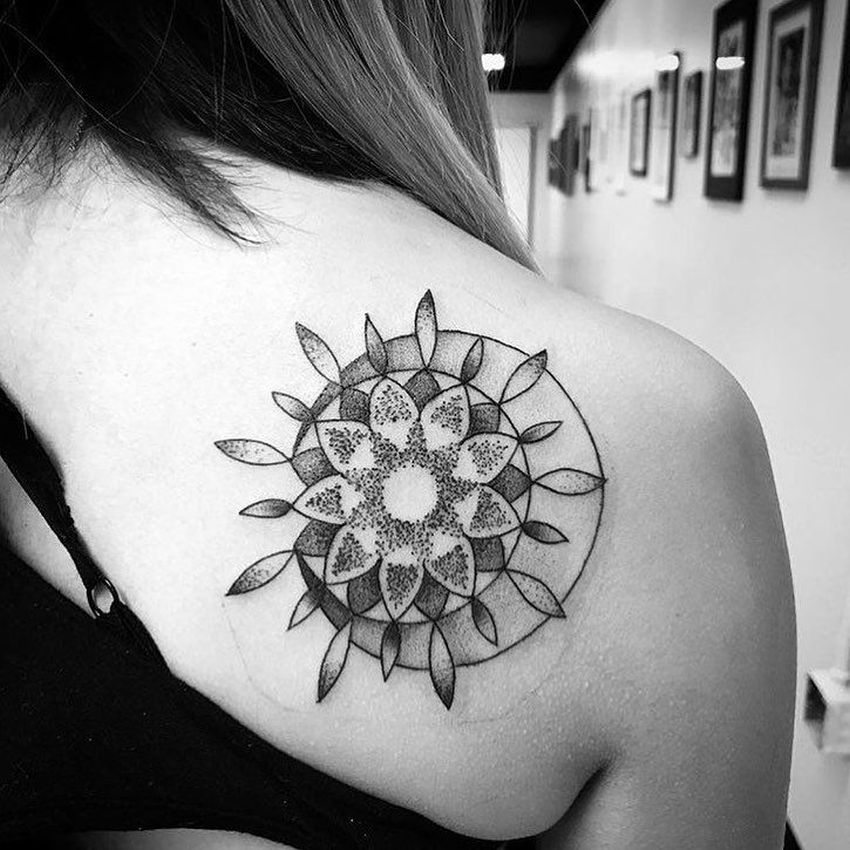 Dotwork moon and sun tattoo on the right shoulder blade