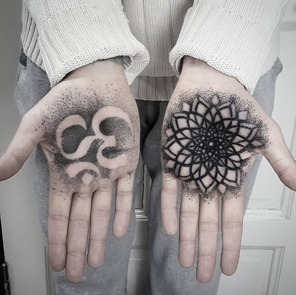 Dotwork om symbol and flower of life tattoo on the palms