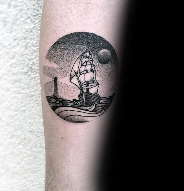 Dotwork sailing ship and lighthouse tattoo on the right arm