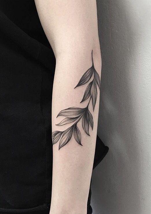 Dotwork style elegant black leaf on the left arm