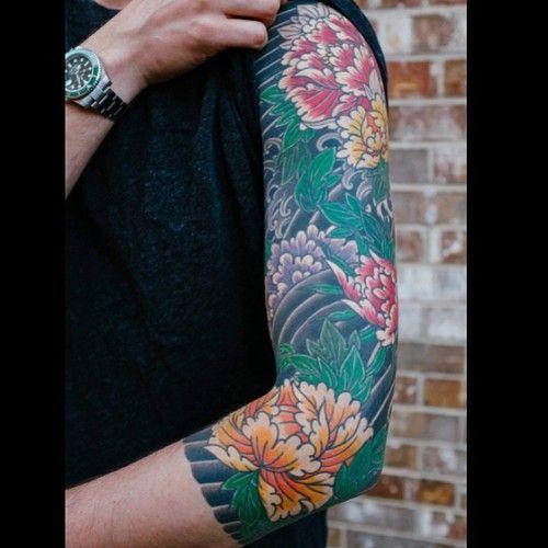 Excelent japanese peony sleeve tattoo