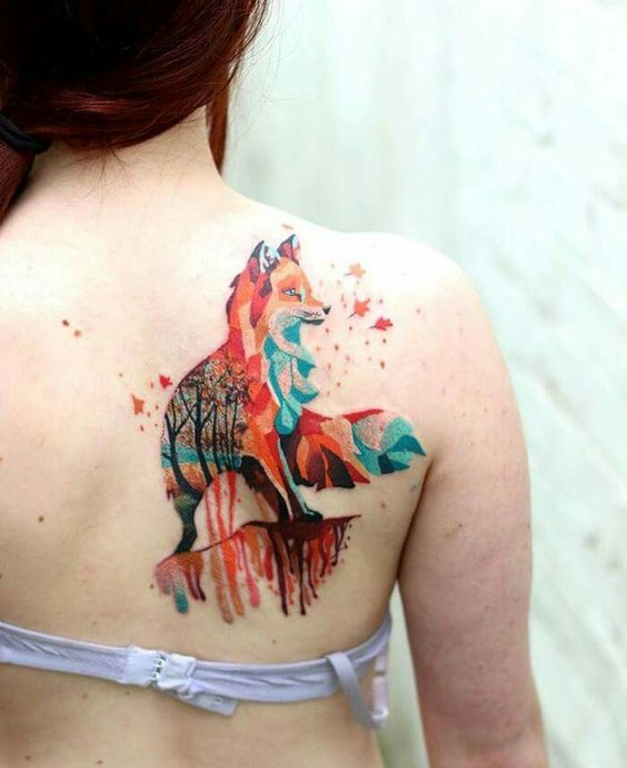 Fantastic colorful fox tattoo on the right shoulder blade