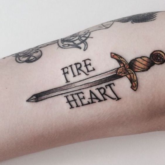 Fire and heart sword tattoo
