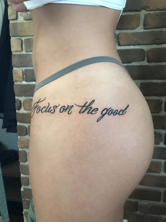 Focus on the good quote tattoo on the left hip