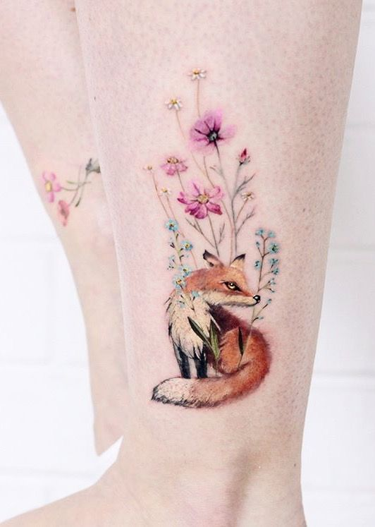 Fox and the flowers tattoo on the left ankle