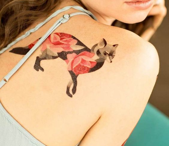 Fox tattoo with a flower on the right shoulder blade by sasha unisex