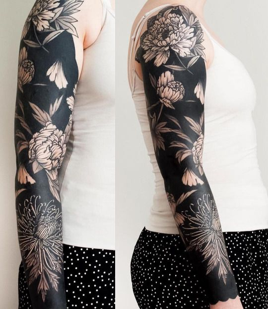 Full sleeve negative space floral tattoo
