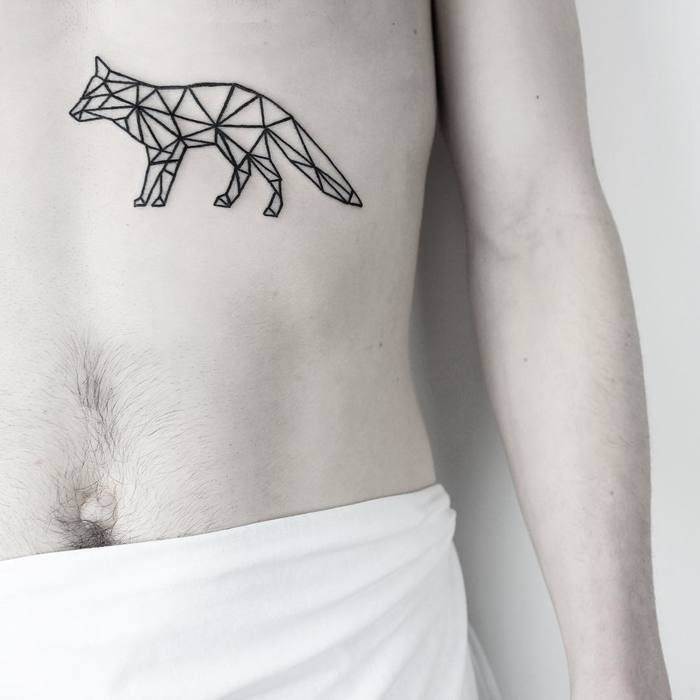 Geometric black fox tattoo on the belly