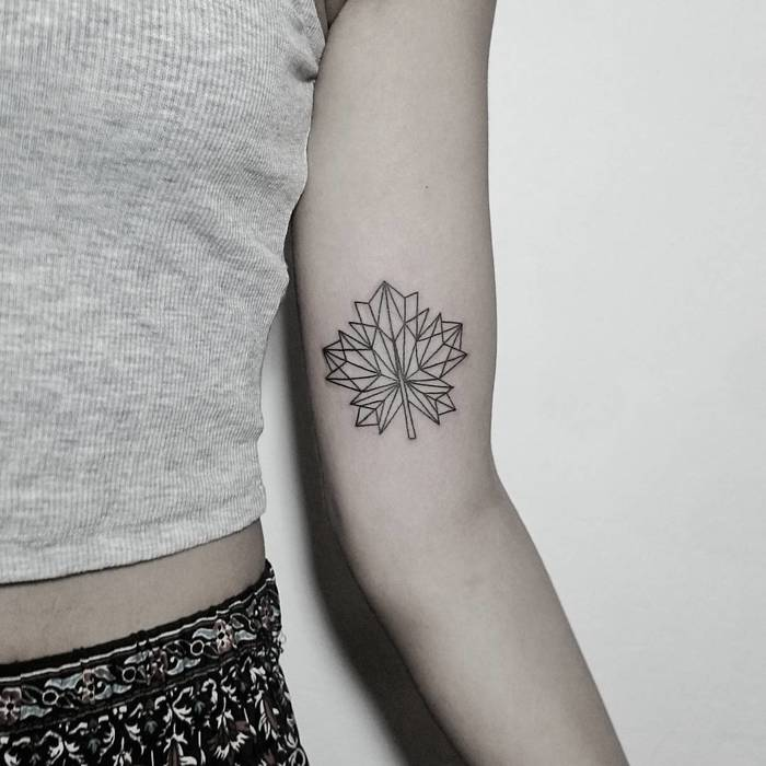 Geometric maple leaf tattoo