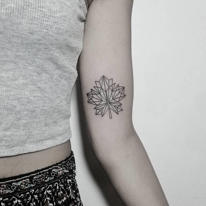 Geometric maple leaf tattoo