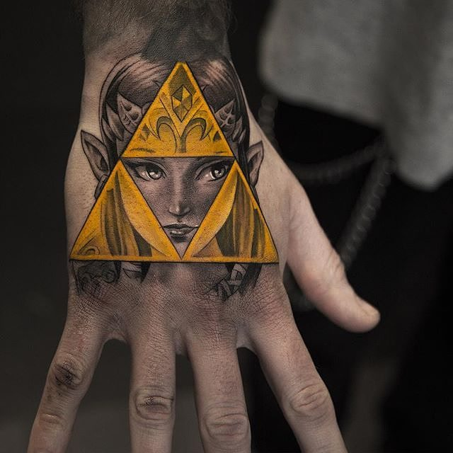 Golden triforce and the goddess of the widsom nayru tattoo
