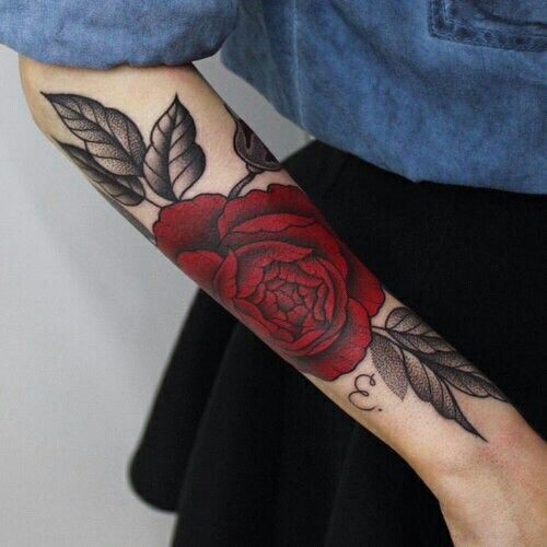 Gorgeous red and black traditional rose tattoo on the right forearm