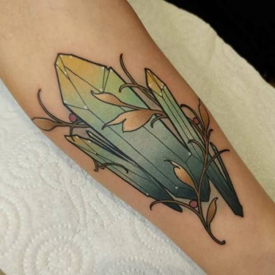 Green and yellow crystal tattoo