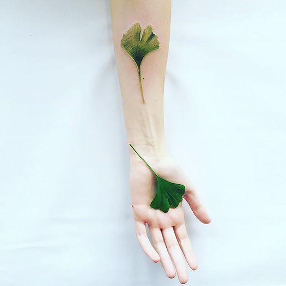 Green ginkgo leaf tattoo by pis saro