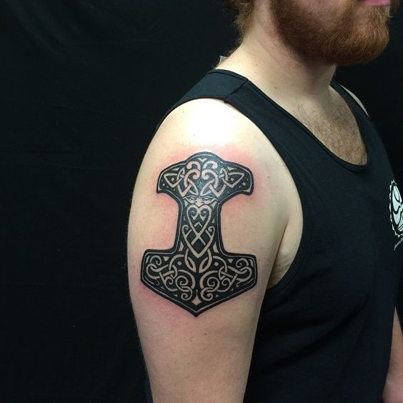 Hammer of the thor tattoo on the right arm