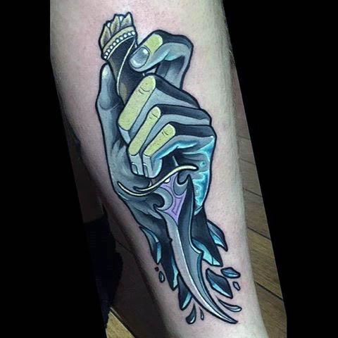 Hand holding a dagger