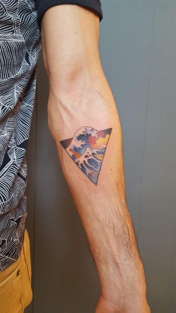 Hokusai wave tattoo in triangle on the left arm