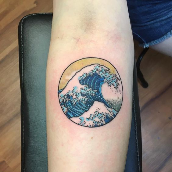 Japanese style blue wave tattoo