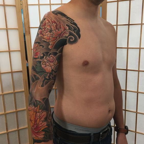 Japanese style full sleeve tattoo with peonies