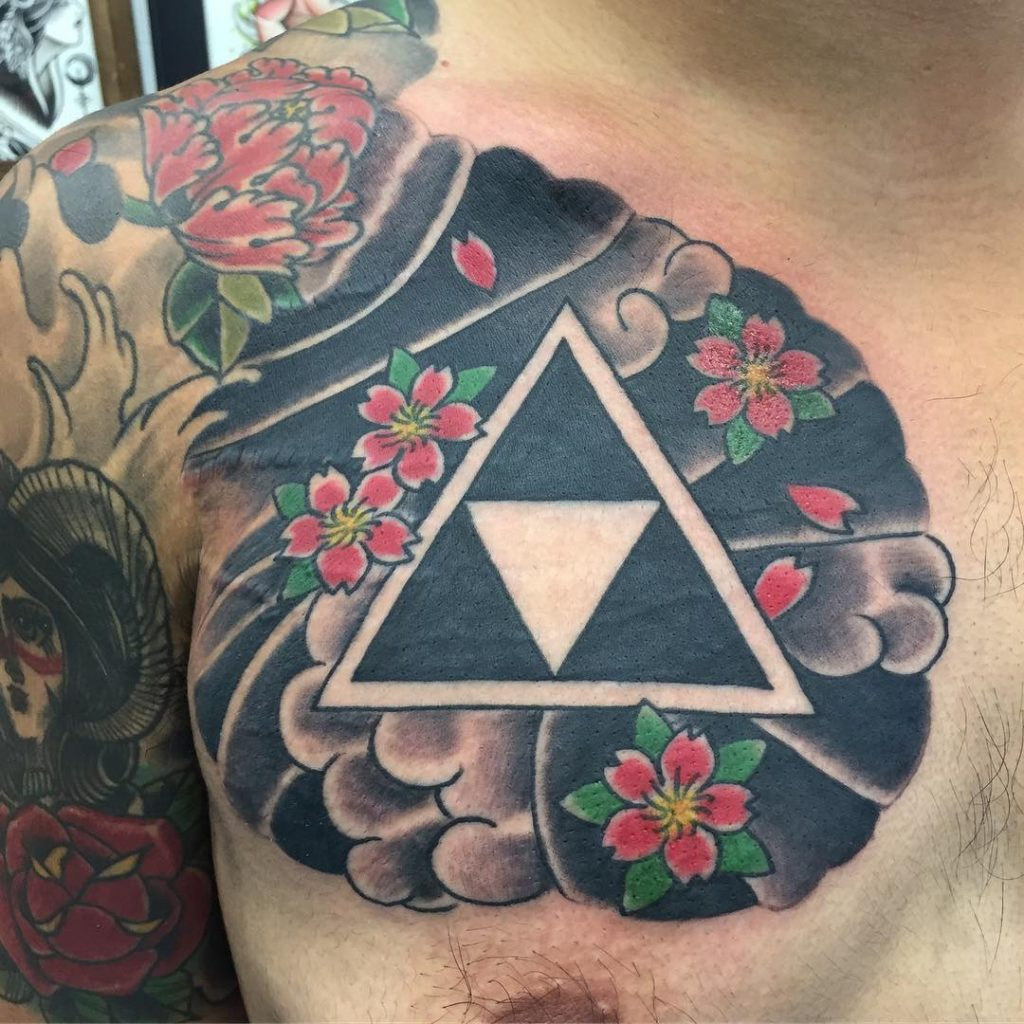 Japanese style triforce tattoo on the chest