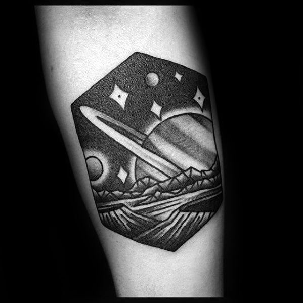 Landscape tattoo of a rising saturn and other planets