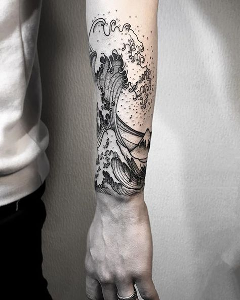 Large black wave tattoo on the left arm
