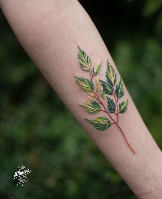 Leaves tattoo on the arm by magdalena bujak