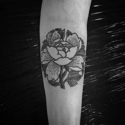 Linework black tattoo of a peony on the arm