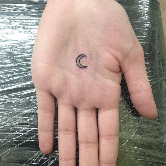 Little crescent moon at the center of the left palm