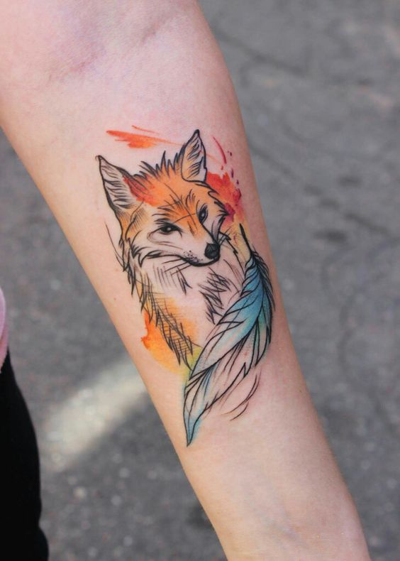 Lovely and simple fox tattoo on the left inner arm