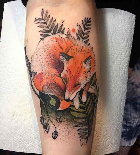 Lovely sleeping fox tattoo
