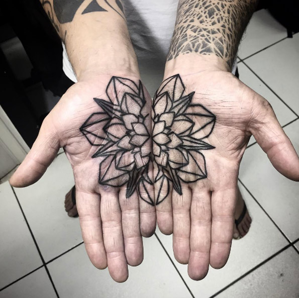 Matching black outline flower palm tattoo