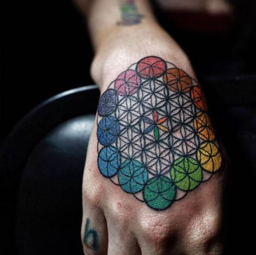 Multicolor flower of life tattoo