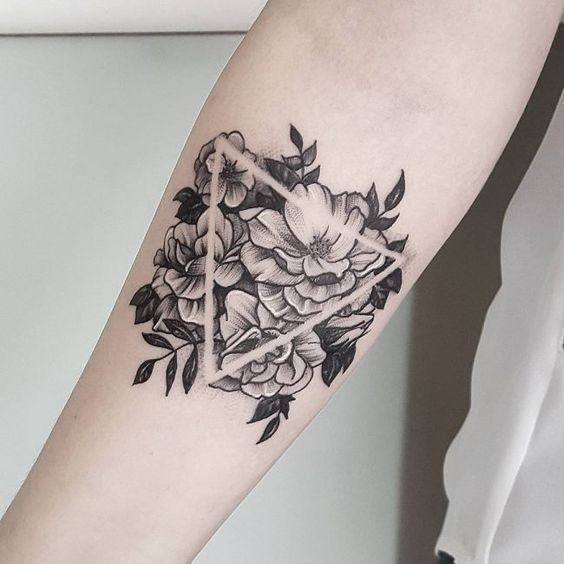 Negative space tattoo of peony and triangle