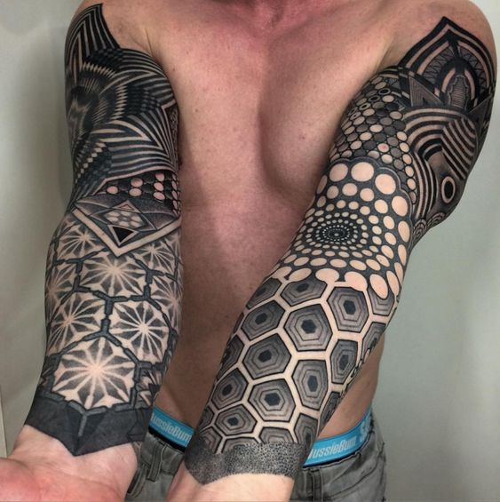 Negative space tattoos on both sleeve by tattooist nissaco