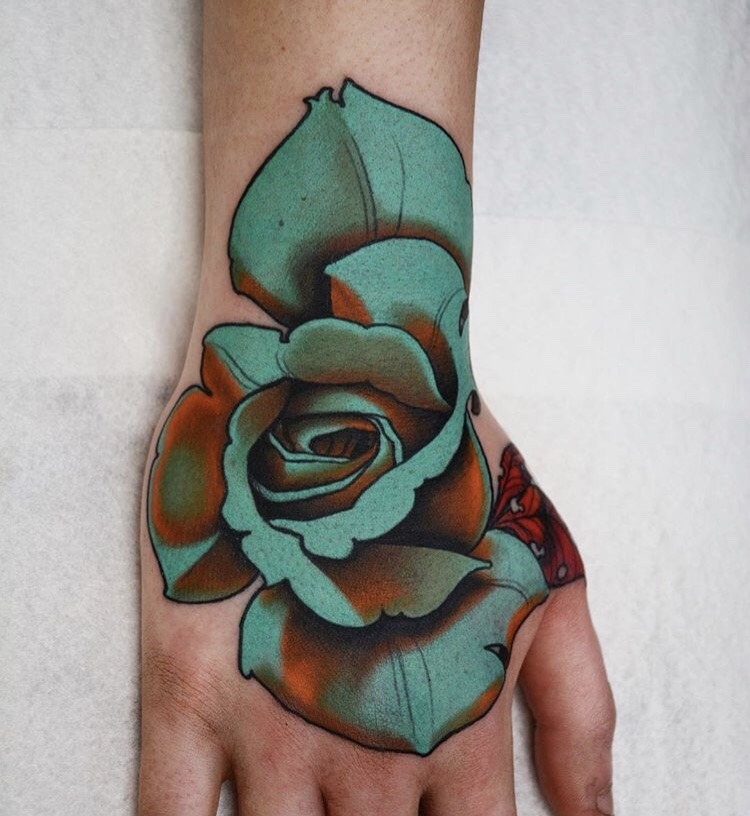 Neo traditional green rose tattoo on the hand