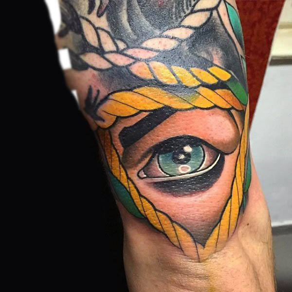 Neo traditional realistic eye tattoo on the back of the right arm