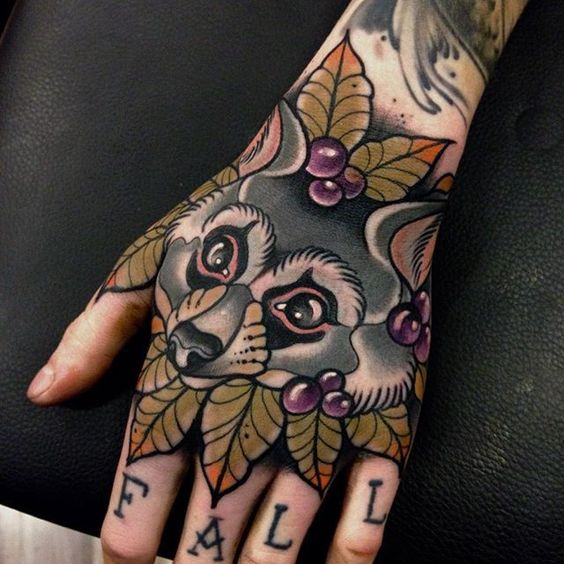 Neo traditional style raccoon tattoo