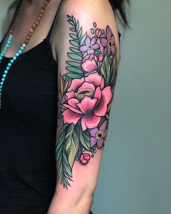 Neo traditional wildflowers tattoo on the left upper arm