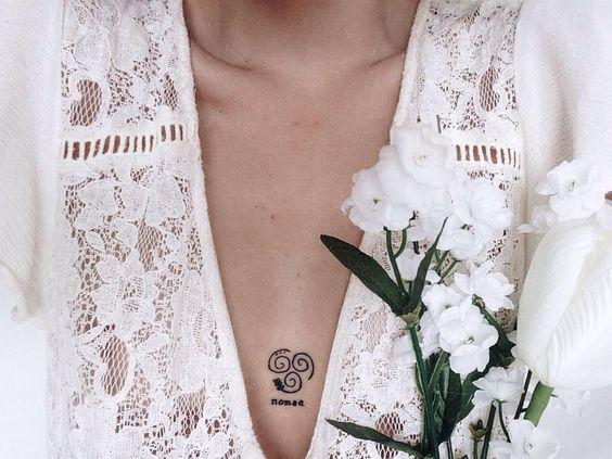 Nomad small breastbone tattoo