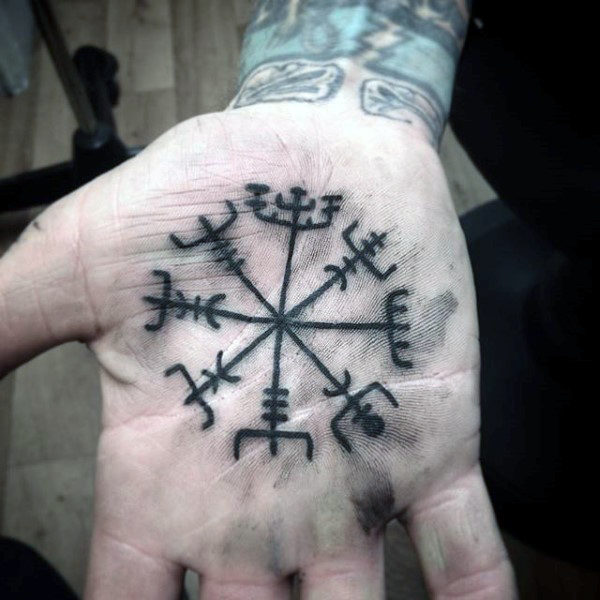Nordic symbol vegvisir tattoo on the palm