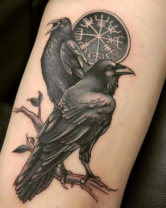 Odins ravens huginn and muninn tattoo with a nordic stave the helm of awe