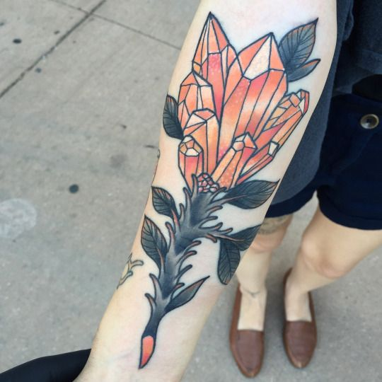 Old school orange crystal flower tattoo on the right arm