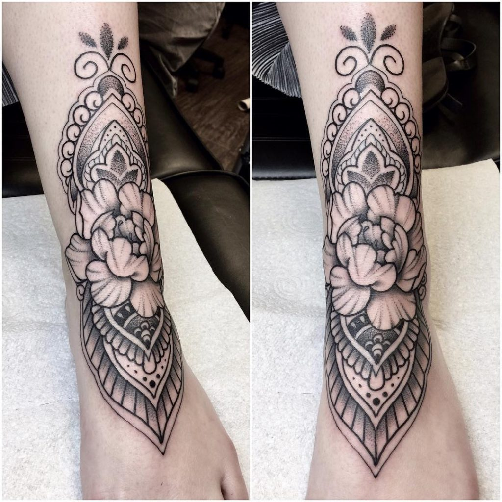 Peony and geometric pattern tattoo on the foot