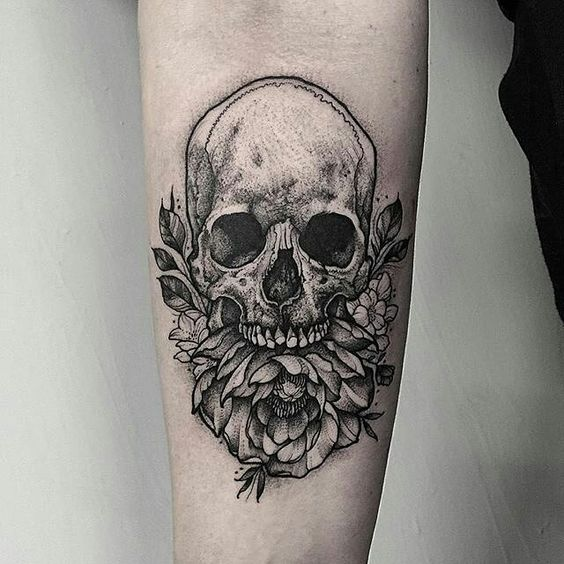 Peony and skull tattoo on the right arm