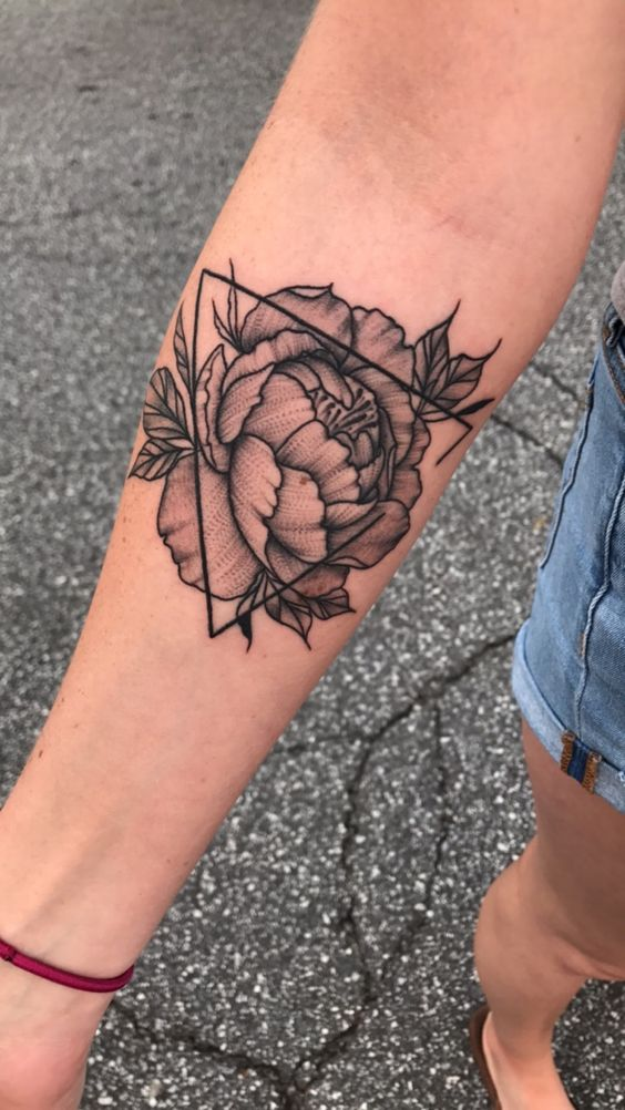 Peony and triangle tattoo on the right arm