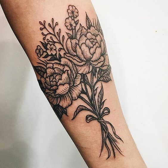 Peony bouquet tattoo on the arm
